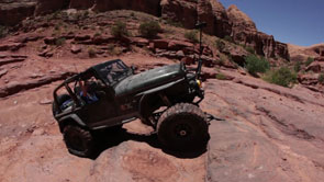 Black 4WD Driving Up the Rocks